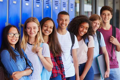 Group of Students Standing in Front of a row of school lockers